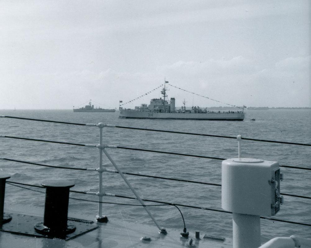 HMCS Buckingham, dressed ship, Spithead, England, Victoria Day, May 18, 1964.